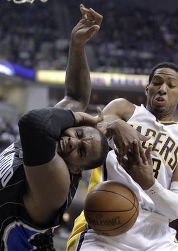 Orlando Magic forward Glen Davis, left, is fouled by Indiana Pacers forward Danny Granger during the first half of Game 2 of an NBA first-round playoff basketball series in Indianapolis, Monday, April 30, 2012. (AP Photo/Michael Conroy)