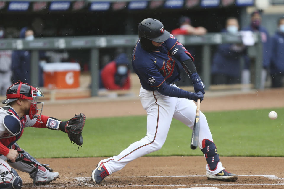 Minnesota Twins' Mitch Garver (8) swings at the ball during the first inning of a baseball game against the Boston Red Sox, Tuesday, April 13, 2021, in Minneapolis. (AP Photo/Stacy Bengs)