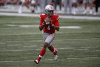 Ohio State quarterback Justin Fields drops back to pass against Nebraska during the second half of an NCAA college football game Saturday, Oct. 24, 2020, in Columbus, Ohio. Ohio State defeated Nebraska 52-17. (AP Photo/Jay LaPrete)