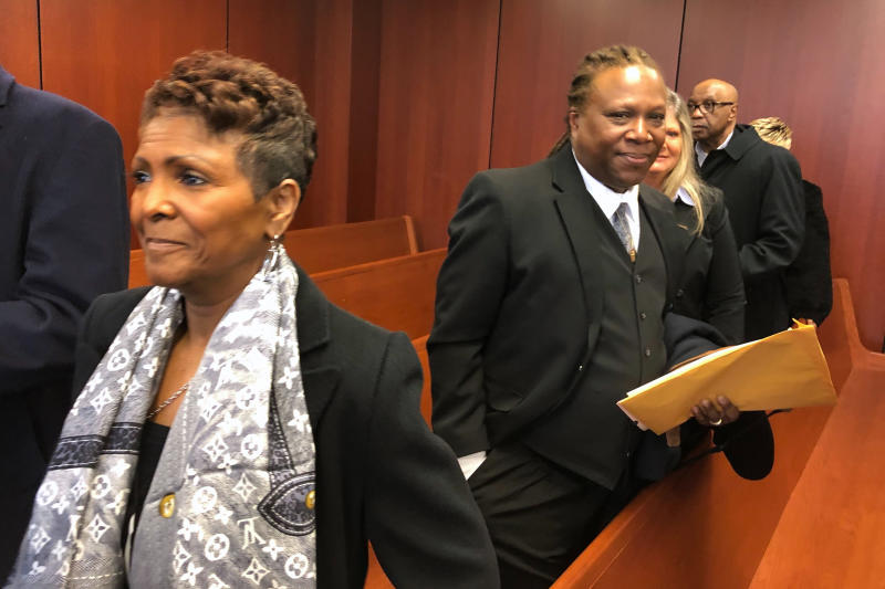 Sabrina Owens, left, the niece of Aretha Franklin, and Franklin's son, Ted White, right, leave a courtroom in Pontiac, Mich., Tuesday. March 3, 2020. A judge accepted Owens' resignation as personal representative, or executor, of the late singer's estate but declined to appoint White as an interim replacement. (AP Photo/Ed White)