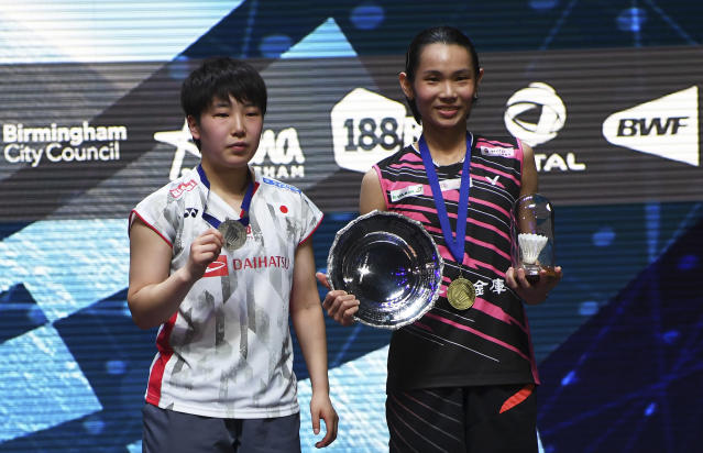 Winner Taiwan's Tai Tzu Ying, right, and second placed Japan's Akane Yamaguchi pose on the podium after the women's singles final match at the All England Open Badminton tournament in Birmingham, England, Sunday March 18, 2018. (AP Photo)