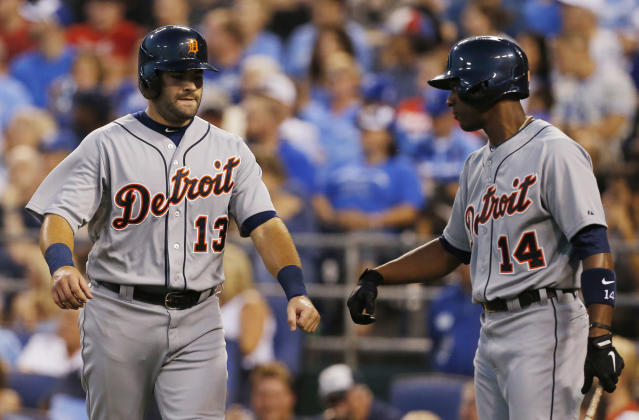 Detroit Tigers' Alex Avila (13) is congratulated by teammate Austin Jackson (14) after scoring on a double by Ramon Santiago during the second inning of a baseball game against the Kansas City Royals at Kauffman Stadium in Kansas City, Mo., Friday, Sept. 6, 2013. (AP Photo/Orlin Wagner)