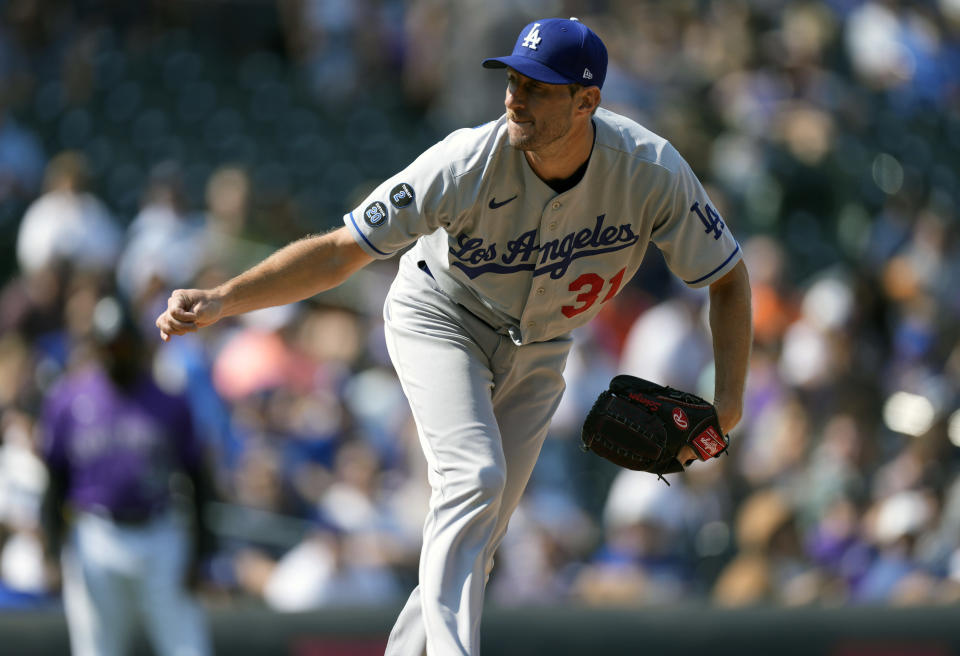 Los Angeles Dodgers starting pitcher Max Scherzer works against the Colorado Rockies in the first inning of a baseball game Thursday, Sept. 23, 2021, in Denver. (AP Photo/David Zalubowski)