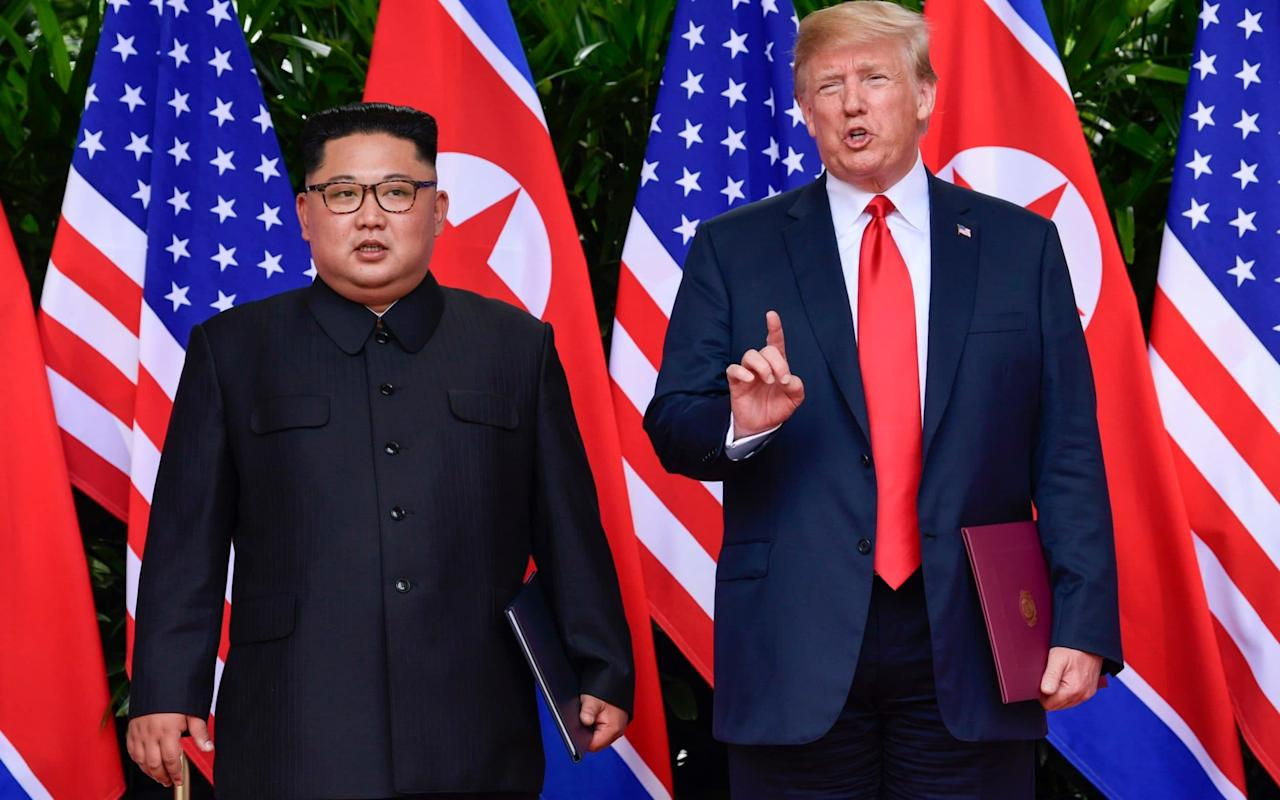 "President Donald Trump on Friday cited ""an unusual and extraordinary threat"" from North Korea's nuclear arsenal to extend sanctions on Kim Jong-un's regime, despite touting the success of a historic summit earlier this month. After flying back to Washington last week, boasting of success, the US leader tweeted: ""There is no longer a Nuclear Threat from North Korea."" ""Sleep well tonight!"" he added on June 13, a day after the Singapore meeting. But a presidential declaration sent to Congress on Friday struck a different note as it explained why the administration would keep in place tough economic restrictions first imposed by former president George W Bush. ""The existence and risk of proliferation of weapons-usable fissile material on the Korean Peninsula and the actions and policies of the Government of North Korea continue to pose an unusual and extraordinary threat to the national security, foreign policy, and economy of the United States,"" it said. Trump-Kim summit in pictures: Best photos from Donald Trump and Kim Jong-un's meeting in Singapore ""I am continuing for one year the national emergency with respect to North Korea,"" added the statement. Though the notice is considered pro forma, the disparity in tone reflects the work that US officials concede remains to be done as negotiators thrash out the details of Pyongyang's disarmament. At their summit, Kim and Mr Trump signed a pledge ""to work towards complete denuclearisation of the Korean Peninsula,"" a stock phrase favoured by Pyongyang that stopped short of longstanding American demands for North Korea to give up its atomic arsenal in a ""verifiable"" and ""irreversible"" way. Inside North Korea - forbidden photos Critics have pointed to the vague wording of the non-binding summit document and raised fears that the summit could weaken the international coalition against the North's nuclear program. Also on Friday, the US and South Korea agreed to indefinitely suspend two exchange programme training exercises, to support diplomatic negotiations with North Korea, the Pentagon said. The move came after the two countries had previously announced the shelving of the large-scale Ulchi Freedom Guardian exercises slated for August, making good on a pledge by Trump during his summit. The decision followed a meeting between Defense Secretary Jim Mattis, Secretary of State Mike Pompeo, Chairman of the Joint Chiefs of Staff Joe Dunford, and National Security Adviser John Bolton. ""To support implementing the outcomes of the Singapore Summit, and in coordination with our Republic of Korea ally, Secretary Mattis has indefinitely suspended select exercises,"" Dana White, Pentagon spokeswoman, said in a statement. Two Korean Marine Exchange Programme training exercises scheduled to occur in the next three months have now been shelved. US and South Korean forces have been training together for years, and routinely rehearse everything from beach landings to an invasion from the North, or even ""decapitation"" strikes targeting the North Korean regime. Pyongyang typically reacts furiously. Following drills last year, the North fired ballistic missiles over Japan, triggering global alarm."