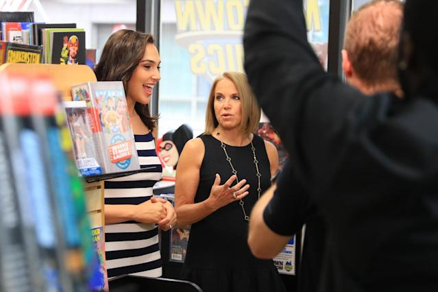 <p>Katie Couric and Gal Gadot walk through Midtown Comics in New York City during an interview on May 23, 2017. (Gordon Donovan/Yahoo News) </p>
