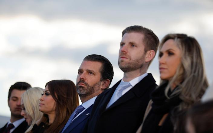 Donald Trump's family appear sombre as they watch his final speech as president - Reuters