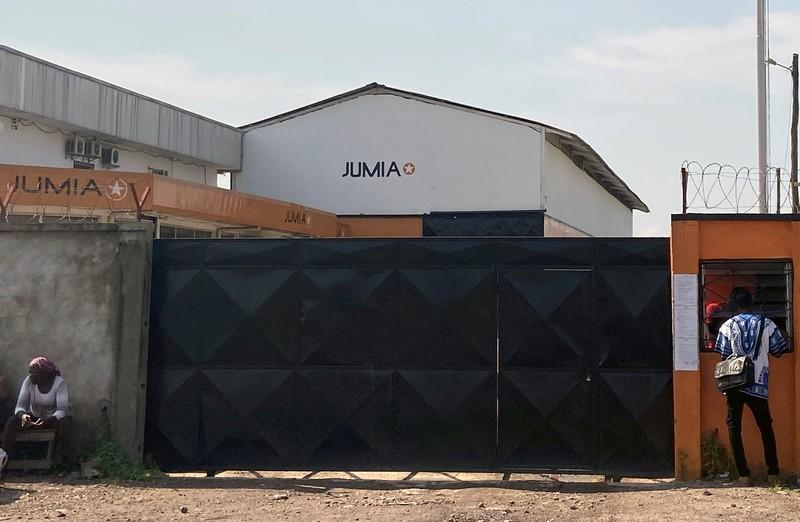 People are seen outside Jumia Technologies headquarters in Douala