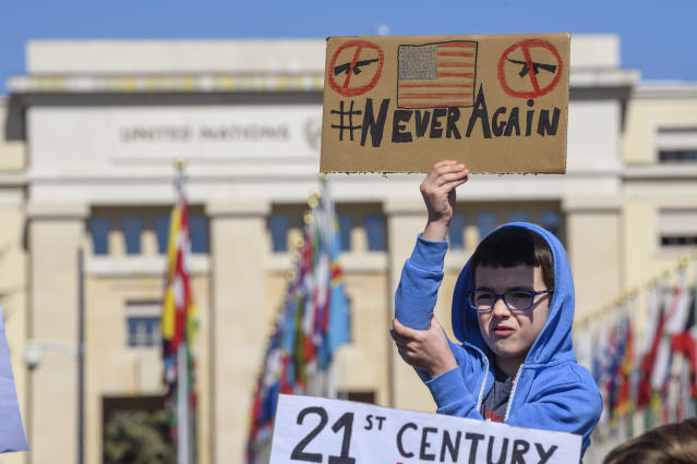 <p>American students and expats hold signs calling for stricter gun control during in a solidarity rally with March For Our Lives on the Place des Nations in front of the European headquarters of the United Nations in Geneva, Switzerland. (Photo: Martial Trezzini/Keystone via AP) </p>