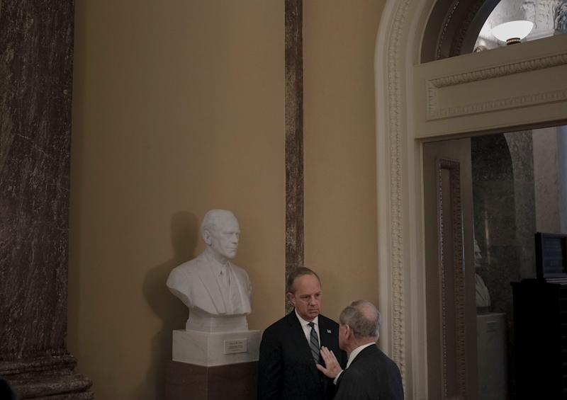 Sen. Jim Risch (R-Idaho) has a private conversation with White House legislative affairs director Eric Ueland off the floor of the senate before the impeachment trial at the Capitol in Washington, D.C., on Jan. 24, 2020. | Gabriella Demczuk for TIME