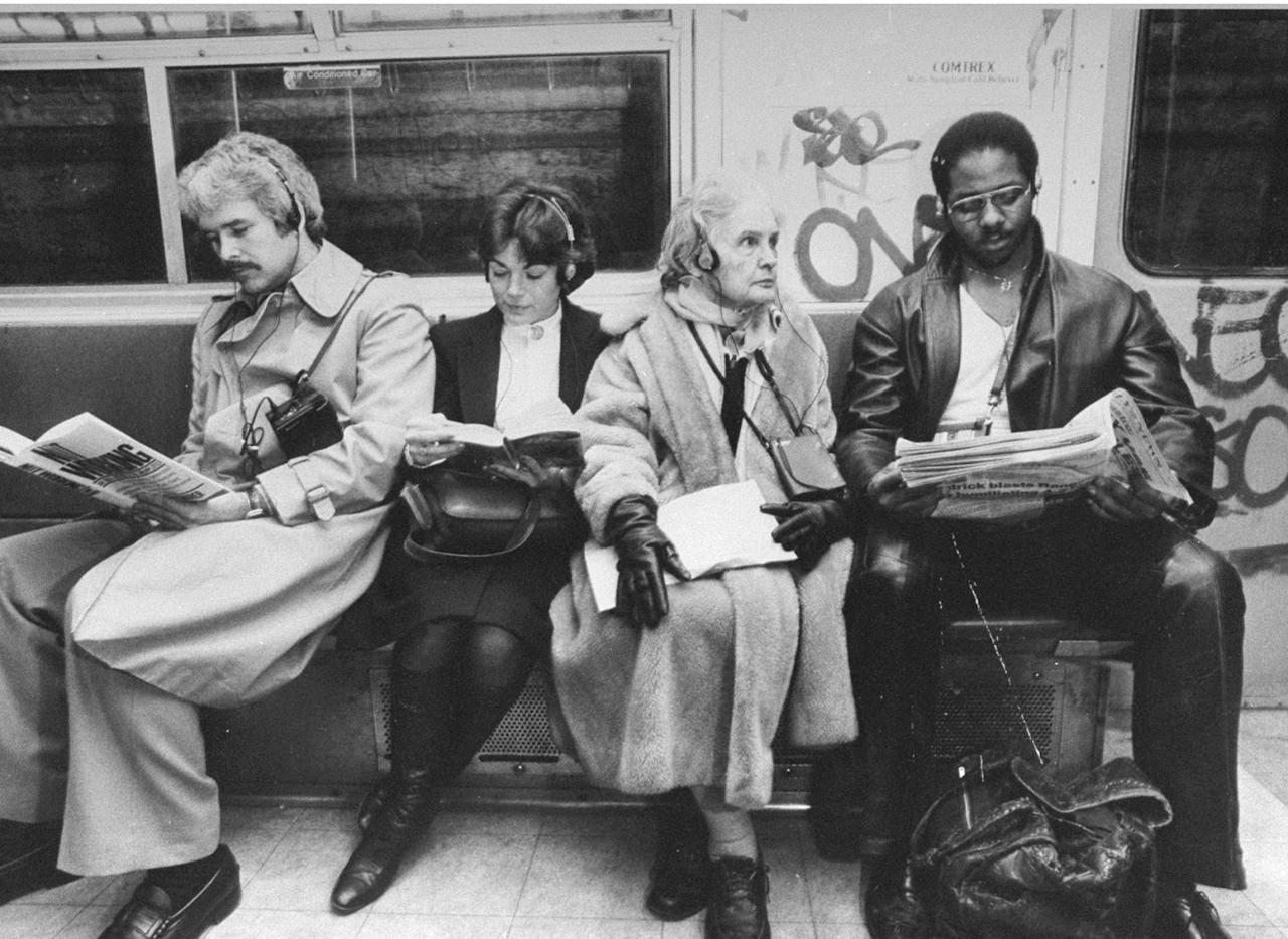 <p>Four commuters listen to their Walkmen's on the New York City subway, 1981.</p>