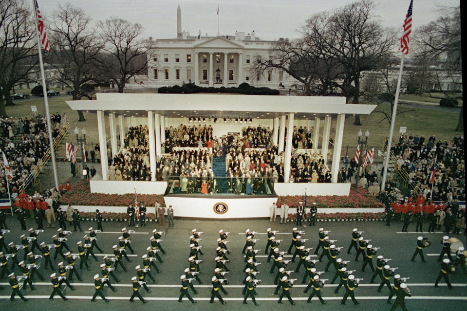 A military unit marches down Washington's Pennsylvania Avenue past the reviewing stand during the inaugural parade held after Ronald Reagan was sworn in as the nation's 40th president in Washington, Jan. 20, 1981. Visible in the background are the White House and the Washington Monument. (AP Photo)