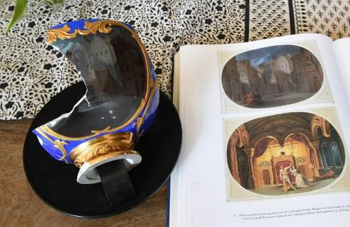 Saved from the ruins of the defeated Nazi Germany in 1945, the fragment at first looks insignificant, consisting of just the blue and gold base of the urnlike vase, and part of one rounded side