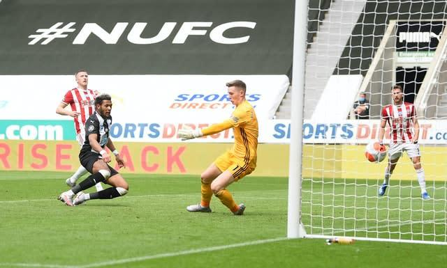 Joelinton scores his second goal for Newcastle, 301 days after the first (Michael Regan/NMC Pool)