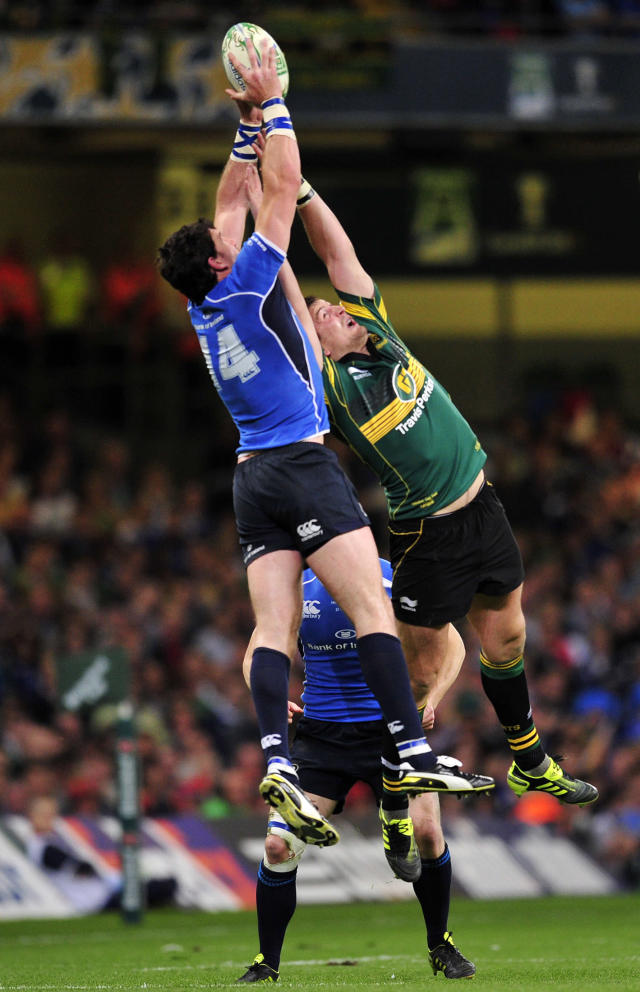 Leinster's Irish winger Shane Horgan (L) vies with Northampton Saints' Irish centre James Downey (R) during their Heineken Cup Final match against Northampton Saints at the Millennium Stadium, Cardiff, Wales, on May 21, 2011. AFP PHOTO/GLYN KIRK NOT FOR MARKETING OR ADVERTISING USE/RESTRICTED TO EDITORIAL USE (Photo credit should read GLYN KIRK/AFP/Getty Images)