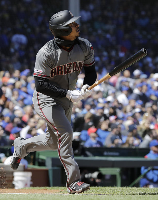 Arizona Diamondbacks' Eduardo Escobar watches as he runs after hitting a solo home run against the Chicago Cubs during the first inning of a baseball game Saturday, April 20, 2019, in Chicago. (AP Photo/Nam Y. Huh)