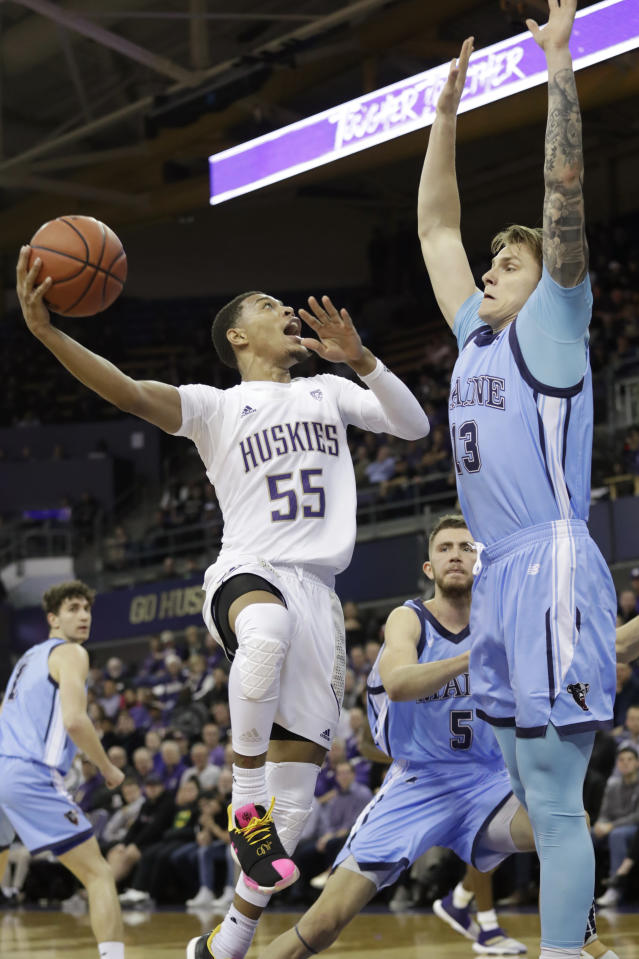 Washington's Quade Green (55) shoots as Maine's Miks Antoms defends during the second half of an NCAA college basketball game Tuesday, Nov. 19, 2019, in Seattle. (AP Photo/Elaine Thompson)