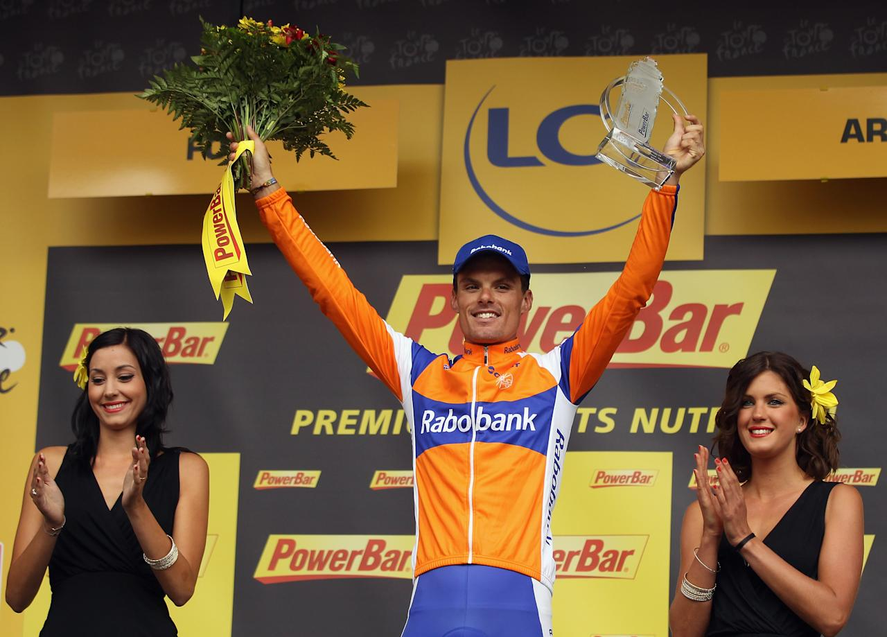 FOIX, FRANCE - JULY 15:  Luis-Leon Sanchez of Spain and the Rabobank Cycling Team stands on the podium to celebrate winning stage fourteen of the 2012 Tour de France from Limoux to Foix on July 15, 2012 in Foix, France.  (Photo by Bryn Lennon/Getty Images)
