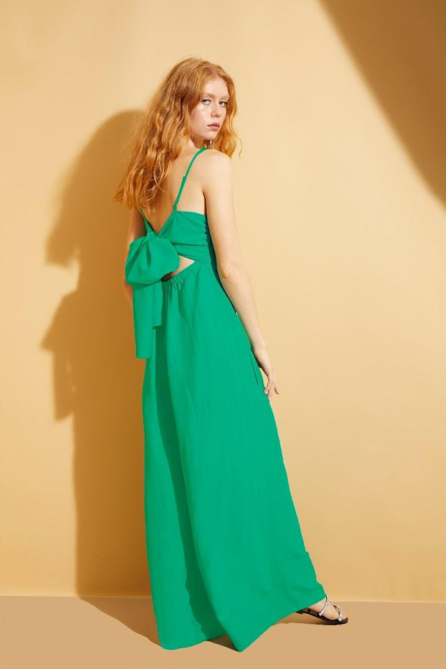 """<p>This <a href=""""https://www.popsugar.com/buy/Hope-Flowers-Jade-Tie-Back-Jumpsuit-579188?p_name=Hope%20For%20Flowers%20Jade%20Tie-Back%20Jumpsuit&retailer=hopeforflowers.com&pid=579188&price=298&evar1=fab%3Aus&evar9=47524904&evar98=https%3A%2F%2Fwww.popsugar.com%2Ffashion%2Fphoto-gallery%2F47524904%2Fimage%2F47525073%2FHope-For-Flowers-Jade-Tie-Back-Jumpsuit&list1=shopping%2Cjumpsuits%2Cfashion%20shopping%2Crompers%2Ccomfortable%20clothes&prop13=mobile&pdata=1"""" rel=""""nofollow"""" data-shoppable-link=""""1"""" target=""""_blank"""" class=""""ga-track"""" data-ga-category=""""Related"""" data-ga-label=""""https://hopeforflowers.com/products/solid-cupro-tie-back-jumpsuit?_pos=1&amp;_sid=e795ed676&amp;_ss=r"""" data-ga-action=""""In-Line Links"""">Hope For Flowers Jade Tie-Back Jumpsuit</a> ($298) is all about the cute back.</p>"""