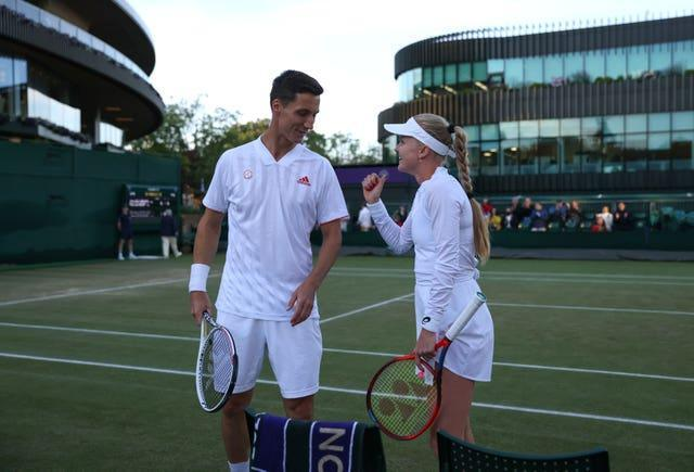 Joe Salisbury (left) and Harriet Dart had a late finish to their mixed doubles match