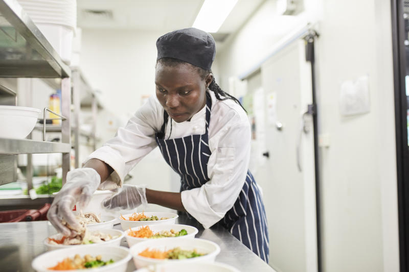 chef prepares food in commercial kitchen