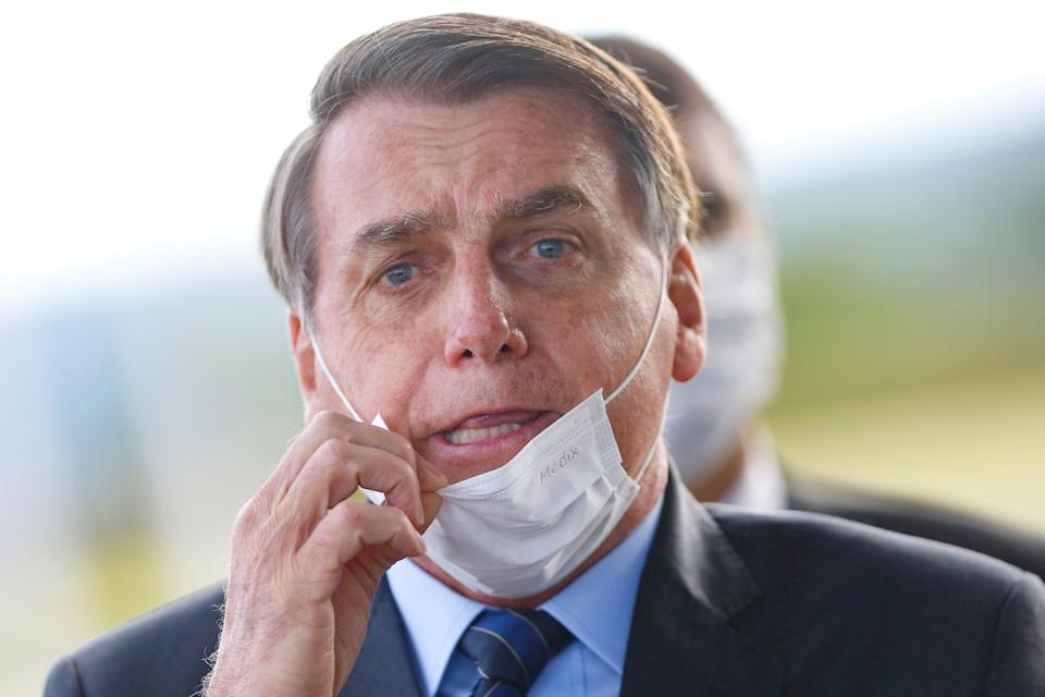 Brazil's President Jair Bolsonaro adjusts his mask as he leaves Alvorada Palace, amid the coronavirus disease (COVID-19) outbreak in Brasilia, Brazil May 13, 2020. REUTERS/Adriano Machado     TPX IMAGES OF THE DAY