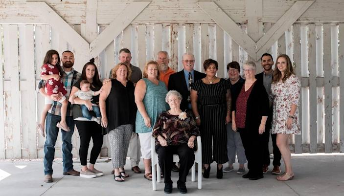Betty Johnson, center, with loved ones during her 90th birthday celebration in September 2019.