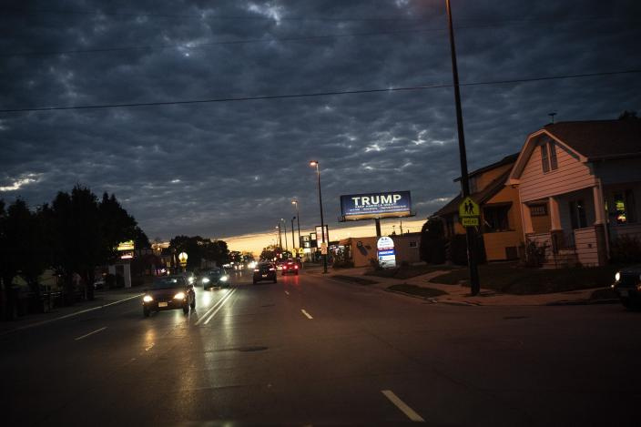 A Trump billboard is illuminated along a street, Saturday, Oct. 31, 2020, in Kenosha, Wis. President Donald Trump has made protest violence in Kenosha and other American cities, a key part of his re-election campaign, linking violence to Democrats and saying it would spread dramatically if Democratic nominee and former Vice President Joe Biden was to defeat him on Election Day. (AP Photo/Wong Maye-E)