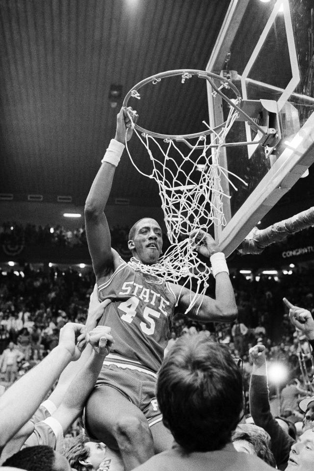 FILE - In this April 4, 1983, file photo, North Carolina State center Cozell McQueen goes after the net during the victory celebration after defeating Houston 54-52 to win the NCAA college basketball championship in Albuquerque, N.M. (AP Photo/File)