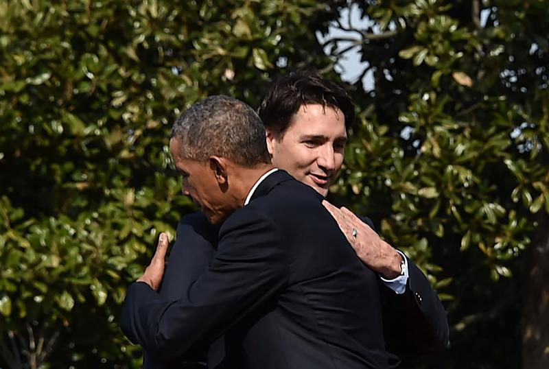 US President Barack Obama and Canada's Prime Minister Justin Trudeau hug during a welcome ceremony at the White House on March 10, 2016