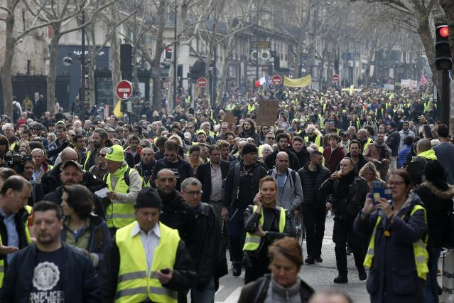 Protesters gather during a rally in Paris, Saturday, March 23, 2019. Yellow vest demonstrators gathered in Paris and other French cities for a 19th round of demonstrations as authorities issued bans on protests in certain areas and enhanced security measures in an effort to avoid a repeat of last week's riots in the capital. (AP Photo/Michel Euler)