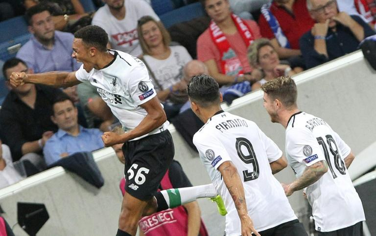 Liverpool's Trent Alexander-Arnold (left) celebrates after scoring the only goal in the Champions League qualifier match against Hoffenheim in Sinsheim, Germany