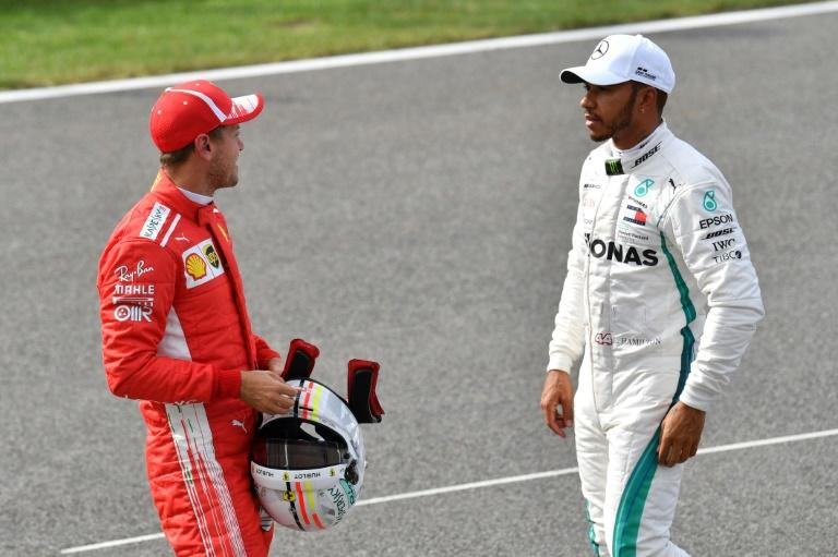 Lewis Hamilton spoke to rival Sebastian Vettel after qualifying and says he hopes to jump the Ferrari drivers on the first lap