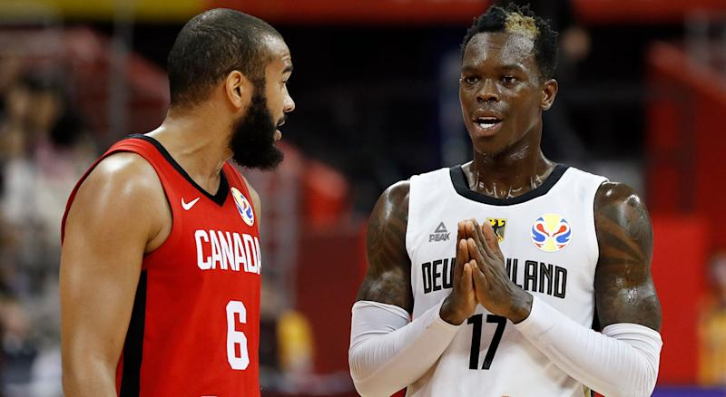 Germany's Dennis Schroder talks to Canada's Cory Joseph. (REUTERS/Aly Song)