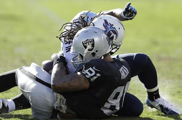 Oakland Raiders tight end Mychal Rivera (81) is hit by Tennessee Titans free safety Michael Griffin during the second quarter of an NFL football game in Oakland, Calif., Sunday, Nov. 24, 2013. Rivera was taken to the locker room and is being evaluated for a head injury after the play. (AP Photo/Ben Margot)
