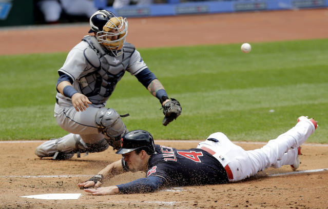 <p>Cleveland Indians' Bradley Zimmer slides safely into home plate as Tampa Bay Rays catcher Jesus Sucre can't hold onto the ball in the third inning of a baseball game,, May 17, 2017, in Cleveland. Zimmer scored on Jason Kipnis's single. (Photo: Tony Dejak/AP) </p>