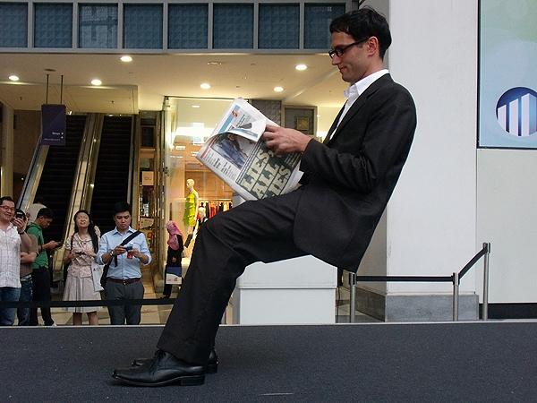 "This man was spotted sitting on an ""invisible chair"" at Raffles Place. (Yahoo! photo/Fann Sim)"