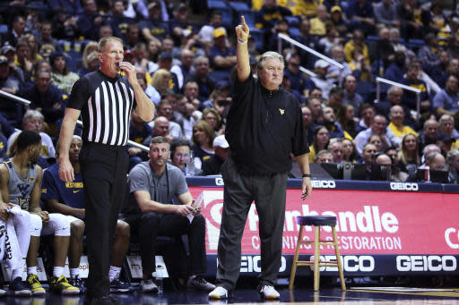 West Virginia coach Bob Huggins reacts to a play during the second half of the team's NCAA college basketball game against TCU on Tuesday, Jan. 14, 2020, in Morgantown, W.Va. (AP Photo/Kathleen Batten)