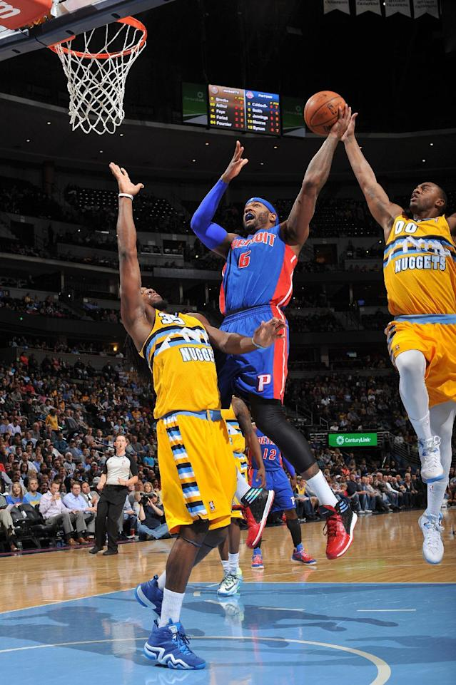 DENVER, CO - MARCH 19: Josh Smith #6 of the Detroit Pistons goes up for the shot against the Denver Nuggets on March 19, 2014 at the Pepsi Center in Denver, Colorado. (Photo by Garrett W. Ellwood/NBAE via Getty Images)