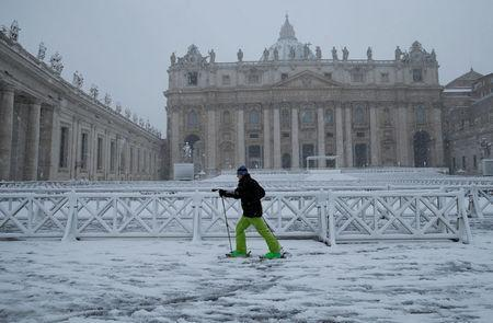 A man skis during a heavy snowfall in Saint Peter's Square at the Vatican. REUTERS/Max Rossi