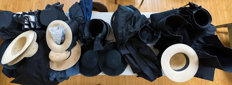 Amish hats and bonnets lie on a table at an event called Jalili Syndrome Family Day May 9 at the community center in La Farge.