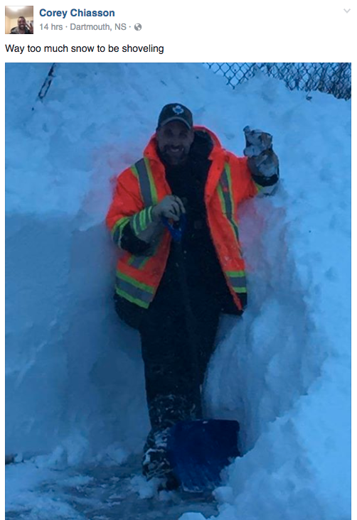<p>In Dartmouth, N.S., a man takes a break from shovelling snow that is almost as tall as he is. Photo from Facebook </p>