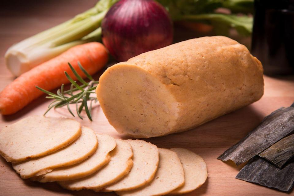 """<p>To coeliacs, its name is apt: seitan is made from gluten, the protein found in wheat. But for others, it's a satisfying meat substitute that packs as much <a href=""""https://www.menshealth.com/uk/nutrition/a755033/the-8-most-common-protein-shake-mistakes/"""" rel=""""nofollow noopener"""" target=""""_blank"""" data-ylk=""""slk:protein"""" class=""""link rapid-noclick-resp"""">protein</a> as lean meat and is a good source of the amino acids needed for vegan muscle-building. Popular in fried """"chick'n"""" restaurants for its meaty texture, it's cheap to make at home, now that you've conquered sourdough.</p>"""