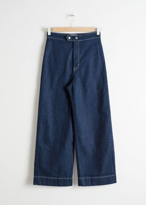"""$89, & Other Stories. <a href=""""https://www.stories.com/en_usd/clothing/jeans/product.high-waisted-flared-jeans-blue.0689665001.html"""">Get it now!</a>"""
