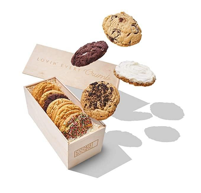 <p>This way for delicious treats. Get the <span>Cookie Society Holiday Dozen Gift Crate</span> ($44).</p>