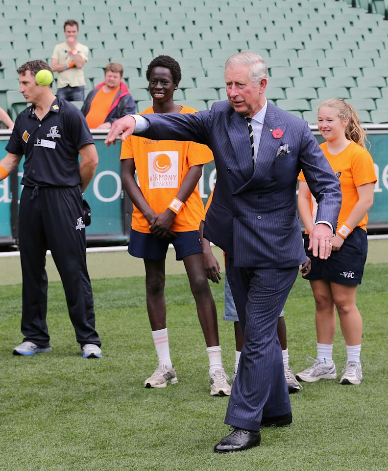 MELBOURNE, AUSTRALIA - NOVEMBER 06:  Prince Charles, Prince of Wales throws a ball as he visits Cricket Victoria's Harmony Programme at the Melbourne Cricket Ground on November 6, 2012 in Melbourne, Australia. The Royal couple are in Australia on the second leg of a Diamond Jubilee Tour taking in Papua New Guinea, Australia and New Zealand.  (Photo by Chris Jackson/Getty Images)