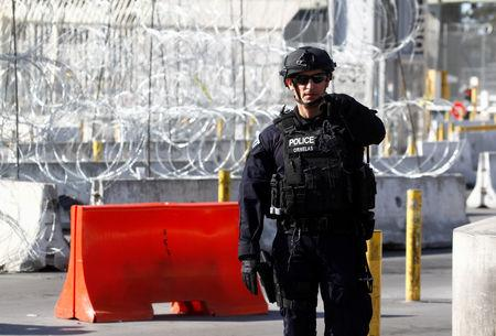 FILE PHOTO: A U.S. Customs and Border Protection agent participates in a test deployment during a large-scale operational readiness exercise at the San Ysidro port of entry with Mexico in San Diego, California, U.S, as seen from Tijuana