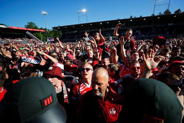 Soccer Football - 2. Bundesliga - SV Sandhausen v Nuremberg - BWT-Stadion am Hardtwald, Sandhausen, Germany - May 6, 2018 Nuremberg fans celebrate promotion after the match REUTERS/Kai Pfaffenbach DFL RULES TO LIMIT THE ONLINE USAGE DURING MATCH TIME TO 15 PICTURES PER GAME. IMAGE SEQUENCES TO SIMULATE VIDEO IS NOT ALLOWED AT ANY TIME. FOR FURTHER QUERIES PLEASE CONTACT DFL DIRECTLY AT + 49 69 650050