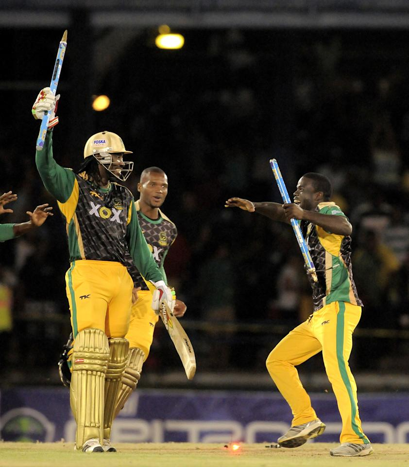 PORT OF SPAIN, TRINIDAD AND TOBAGO - AUGUST 24:  Chris Gayle (L), Dave Bernard Jnr. (C) and Chadwick Walton (R) of Jamaica Tallawahs celebrating victory against Guyana Amazon Warriors during the Final of the Caribbean Premier League between Guyana Amazon Warriors v Jamaica Tallawahs at Queens Park Oval on August 24, 2013 in Port of Spain, Trinidad and Tobago. (Photo by Randy Brooks/Getty Images Latin America for CPL)