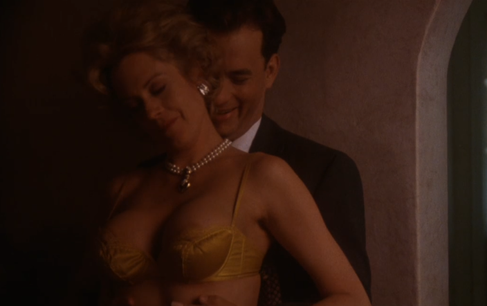 Hanks and Griffith in an intimate scene from 'The Bonfire of the Vanities' (Photo: Warner Bros.)