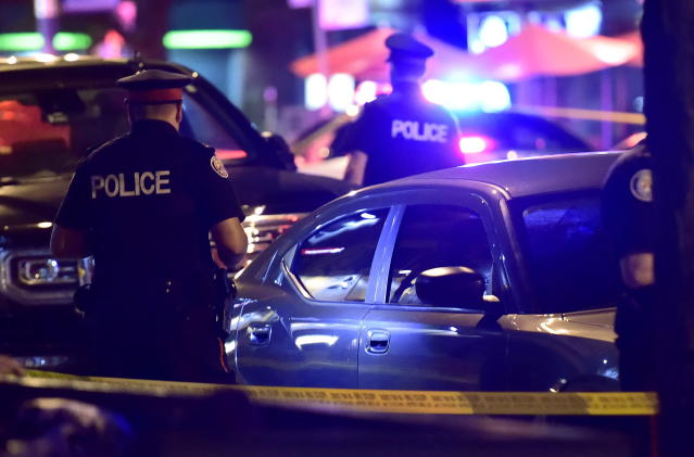 <p>Police work the scene of a shooting, Sunday, July 22, 2018, in Toronto. (Photo: Frank Gunn/The Canadian Press via AP) </p>